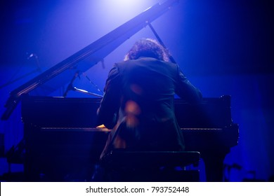 Pianist is playing piano in concert.