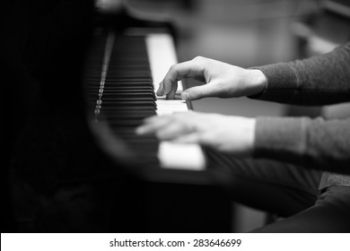 Pianist's hands playing the melody