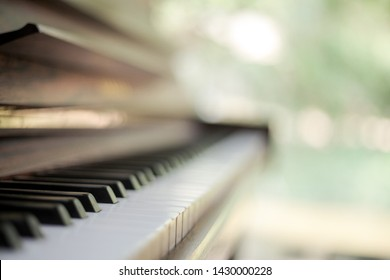 Piano with blurred green background