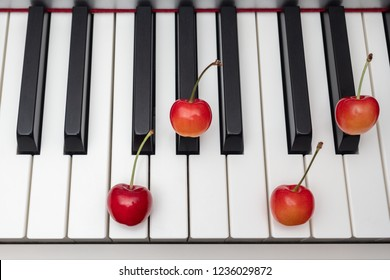 Piano chord shown by cherries on the key - Minor Seventh series - Fm7 (F minor seventh)