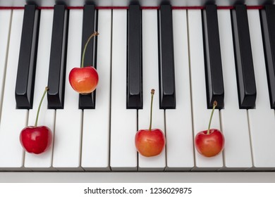 Piano chord shown by cherries on the key - Minor Seventh series - Gm7 (G minor seventh)