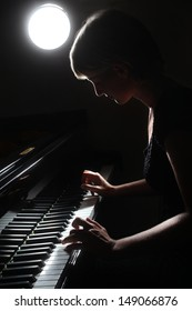 Piano classical music musician player. Pianist with musical instrument grand piano