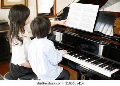 A piano classroom and Japanese boy