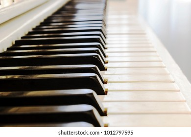 Piano close-up, musical instrument. learn to play the instrument at home. white large piano. piano keyboard. concert concept.