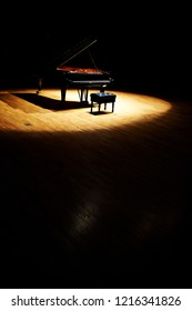 Piano with dramatic lighting