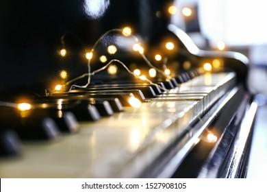 Piano with glowing garland, closeup