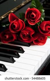 Piano Key and rose close up shot
