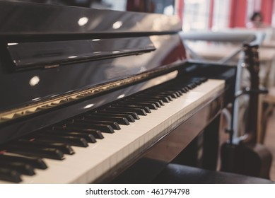 Piano keyboard background with selective focus. old tone.