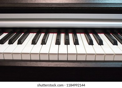 Piano keyboard close up. Elements of musical instrument. Lines and black and white colors of piano keyboard.