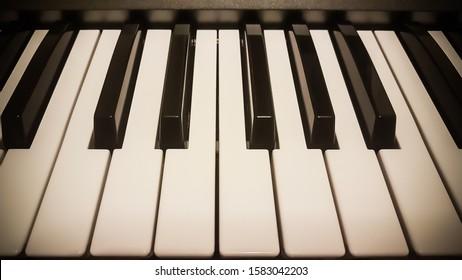 Piano keyboard close-up. Warm colors