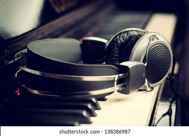 Piano keyboard with headphones for music - Shutterstock ID 138386987