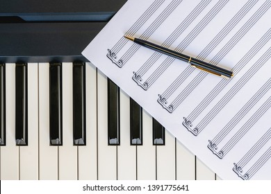 Piano Keyboard, Music Sheet and Pen, Top View, Close Up. Music Instrument, Romance, Concept