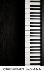 Piano keyboard on dark background
