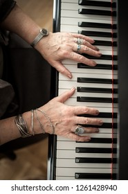 piano keyboard with woman hands