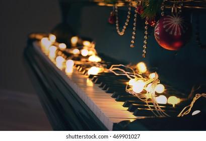 Piano keys with Christmas decorations, closeup