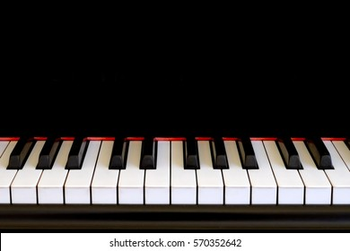 Piano keys close up. Copy space on black background