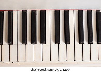 Piano keys close-up. Fortopiano in the interior, a keyboard musical instrument. Play the piano
