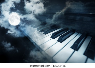 piano keys in moonlight cloudy night