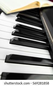piano keys and notepad