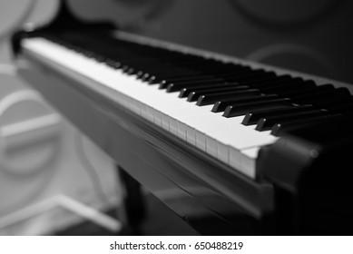 Piano keys on black piano.