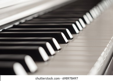 Piano keys side view close-up with shallow depth of field