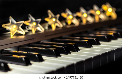 Piano keys with stars lights bokeh in background