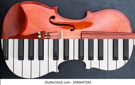 piano keys in to the violin on the black leather table, half keyboard like violin shape