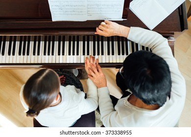piano lesson at a music school, top view