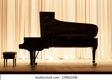 The piano on the brown curtain background