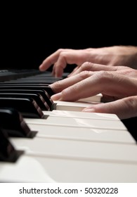 Piano player over black background,closeup shot, shallow DOF