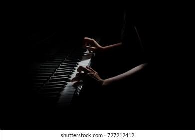 Piano player. Pianist hands playing grand piano keys. Music instrument close up