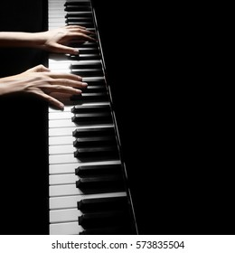 Piano player. Pianist playing musical instrument close up. Grand piano with hands closeup