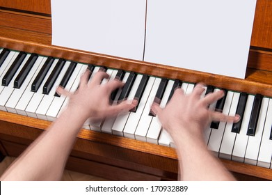 Piano player showing movement of the hands with blank music sheets