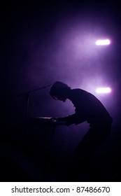 Piano player silhouette