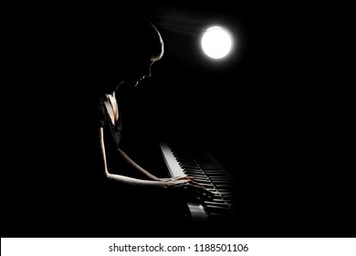 Piano player. Woman playing piano concert. Pianist classical musician playing grand piano