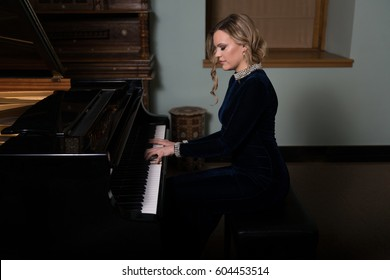 Piano Playing Pianist Concert - Classical Music Musician Player With Grand Piano in Darkness