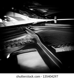 Piano strings and hammer detail black and white