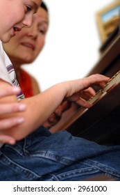 Piano teacher and student during a lesson.  The student's hands are the point of focus