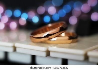 piano and wedding rings so close, love
