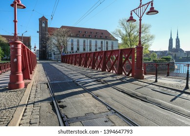 Piaskowy (Sand) Bridge, the oldest iron bridge in the city, connects the Old Town with the Piasek (Sand) Island, Wroclaw, Lower Silesia, Poland - Shutterstock ID 1394647793