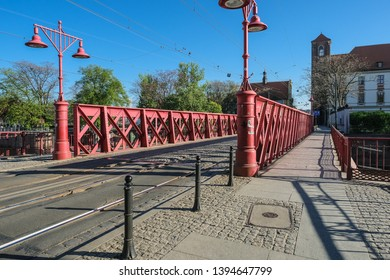 Piaskowy (Sand) Bridge, the oldest iron bridge in the city, connects the Old Town with the Piasek (Sand) Island, Wroclaw, Lower Silesia, Poland - Shutterstock ID 1394647799