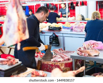PIATIGORSK FOOD MARKET, RUSSIA - 21 MAY, 2019: Piatigorsk central meat market. Men is cutting meat bones.