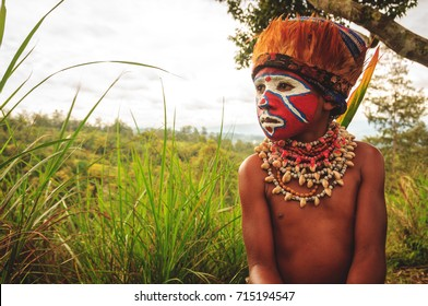 PIAYA, PAPUA NEW GUINEA - AUGUST 12, 2011: Young tribe member in Piaya Village, Papua New Guinea