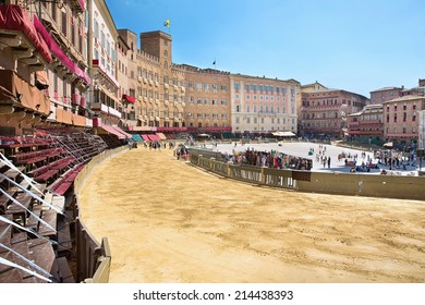 Piazza del Campo in the preparation of the sandy substrate for the place of the Palio horse race, with the Public Palace, Siena, Tuscany, Italy