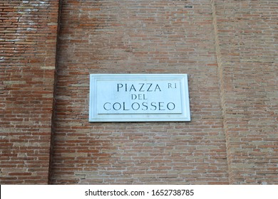 Piazza Del Colosseo street sign on a brick wall at Piazza Del Colosseo in Rome, Italy.