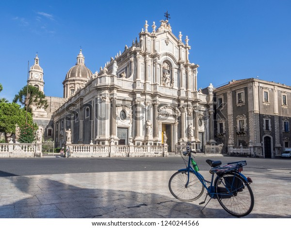 The Piazza del Duomo in Catania city centre with majestic cathedral of St. Agatha with bicycle in the front, Catania, Sicily, Italy