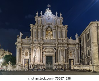 Piazza del Duomo with Cathedral of Santa Agatha at night in Catania, Sicily, Italy.