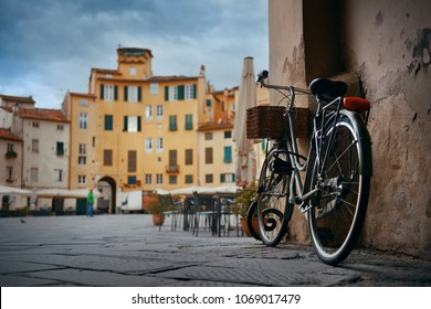Piazza dell Anfiteatro in Lucca Italy with bike