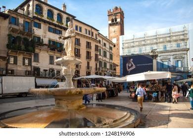 Piazza delle Erbe - Verona Italy / VERONA, ITALY  -23 ottobre 2018.: Piazza delle Erbe, is the oldest square in Verona (UNESCO heritage), and rises over the area of the Roman Forum