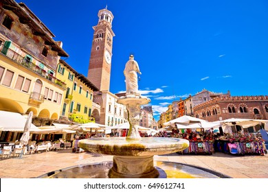 Piazza delle erbe in Verona street and market view with Lamberti tower, tourist destination in Veneto region of Italy